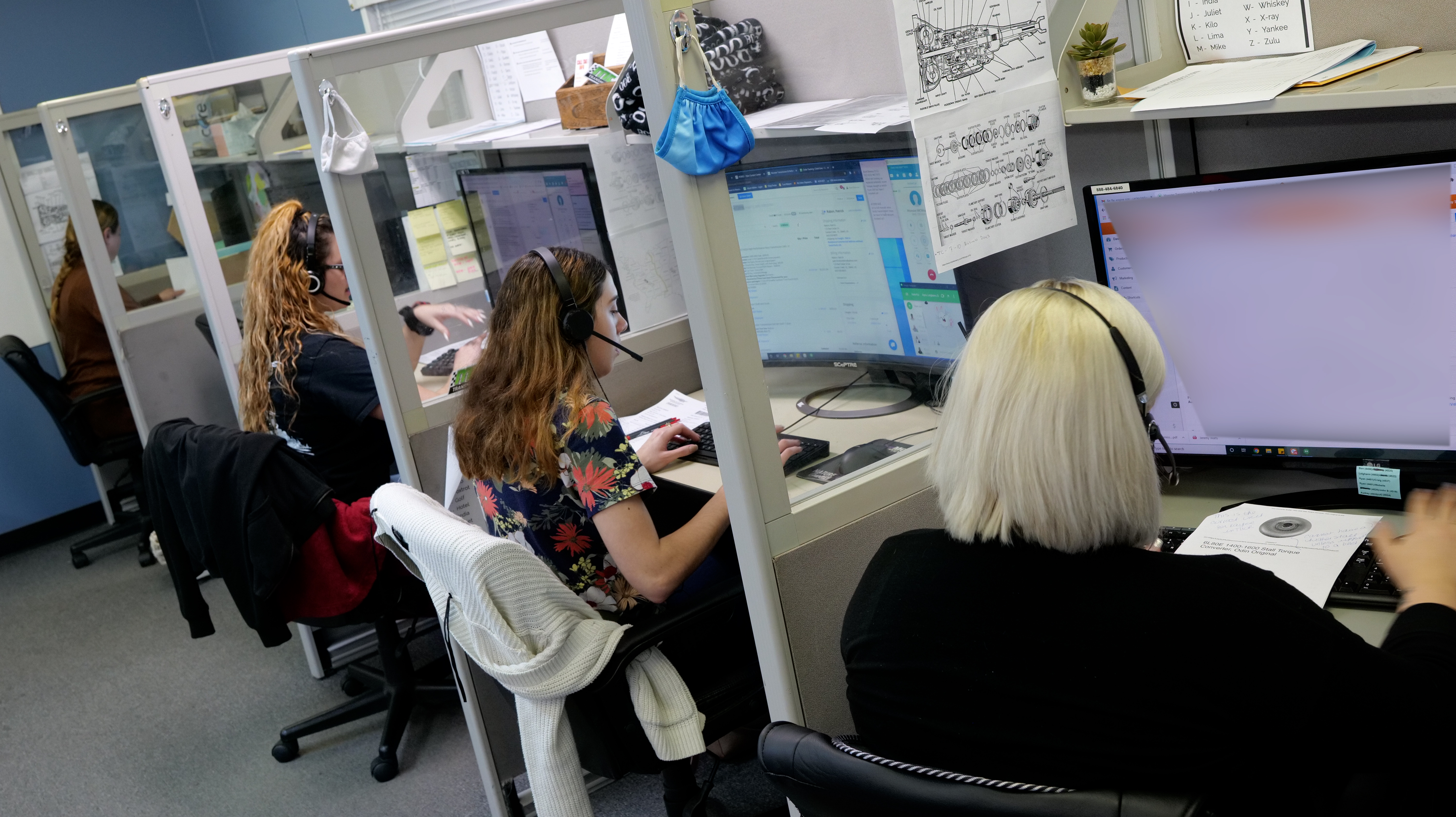 Employees taking calls at their workstations